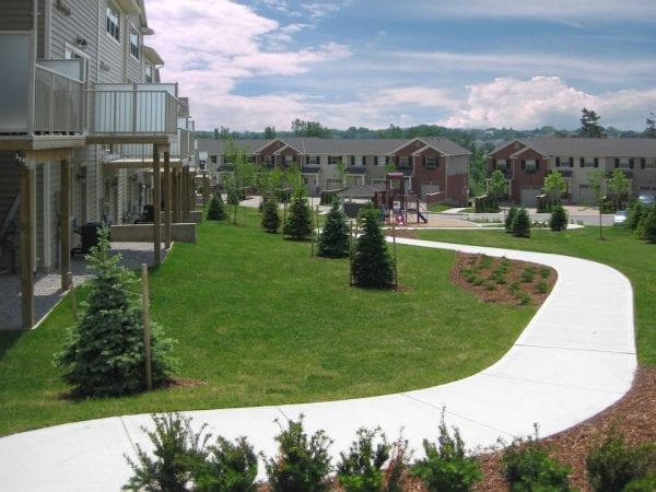 Connected ground floor patios for townhouses near a freshly built path