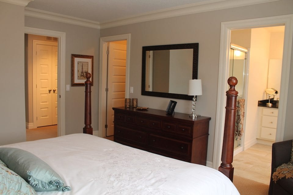 Master bedroom with master bath, walk-in closet and door leading to hallway