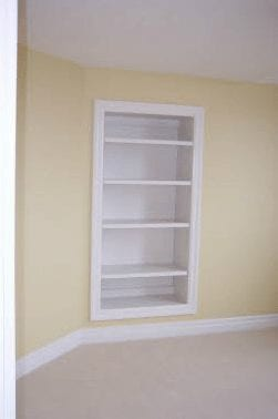 In-wall shelving in a small room
