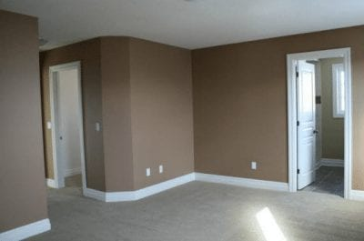 An empty room with doors leading to other rooms
