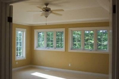 An empty room with a ceiling fan