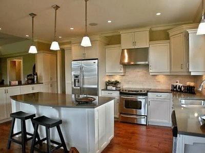 Large kitchen with breakfast bar overlooking dining area