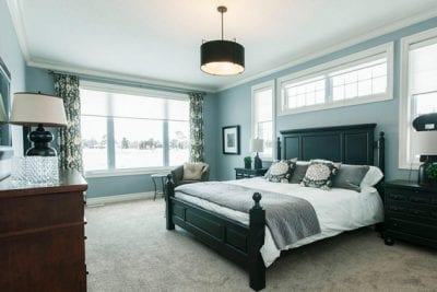 Master bedroom with a bed and large window